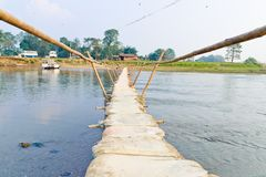 Handmade bamboo wooden sand bag bridge in Chitwan. Nepal Royalty Free Stock Photo