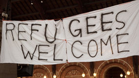 Handmade Banner Refugees Welcome. Is hanged in Copenhagen railroad station by the place where locals bring clothes for refugees stock photography