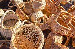 Handmade basket bags stacked pile sell fair market Royalty Free Stock Image
