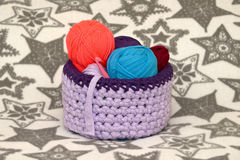 Handmade basket and colorful yarn. Stock Image