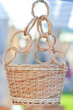 Handmade basket for sale at a souvenir market in Romania. A hanging woven basket for flower pot. Rattan basket hanging Stock Photos