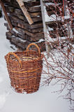 Handmade basket in winter snowy garden Stock Photos