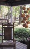 Handmade baskets and chairs. Handmade baskets and rocking chair Stock Photo