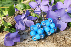 Handmade bead earrings on the nature background Royalty Free Stock Photos