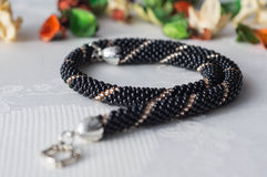 Handmade beaded necklace from beads of black and gold color Royalty Free Stock Photo