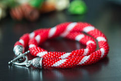 Handmade beaded necklace from beads of red and white color Royalty Free Stock Images