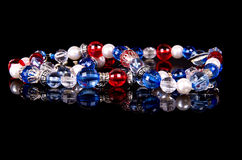 Handmade beads over black Royalty Free Stock Images