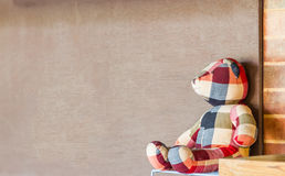 Handmade the bear doll on brown background. Stock Photos