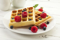 Handmade Belgian waffles with raspberries and blueberries Royalty Free Stock Photos