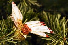 Handmade bird in christmas tree Stock Photo