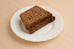 Handmade black bread on plate Royalty Free Stock Images