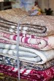 Handmade blankets pile Stock Photo