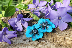 Handmade blue flower clay earrings on the nature background Stock Photos