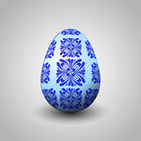 Handmade blue foliage decorated easter egg  Royalty Free Stock Images