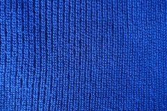 Handmade blue knit stitch fabric from above. Handmade blue plain knit stitch fabric from above Royalty Free Stock Images