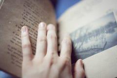 Handmade book. Girl's hand lies on handmade book Stock Photos