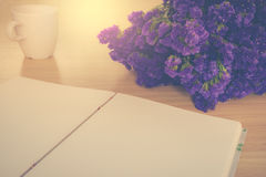 Handmade book and Statice flower on wooden table Royalty Free Stock Image