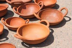 Handmade bowl of baked clay stock photos