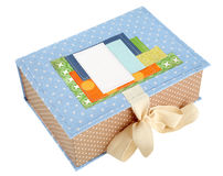 Handmade box tied with a ribbon isolated on a white background. Royalty Free Stock Photos