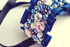 Handmade bracelet with different jewels on white Stock Image