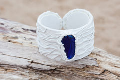 Handmade bracelet with leather on old wood.  Stock Photos