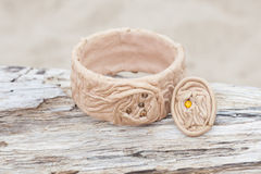 Handmade bracelet with leather on old wood Royalty Free Stock Photography