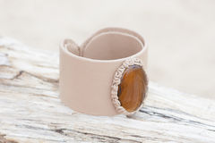 Handmade bracelet with leather on old wood Royalty Free Stock Image