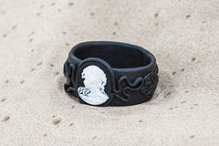 Handmade bracelet with leather on sand.  Royalty Free Stock Images