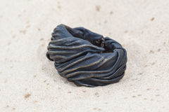 Handmade bracelet with leather on sand.  Royalty Free Stock Photos