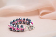 Handmade bracelet with pink pearls Royalty Free Stock Images
