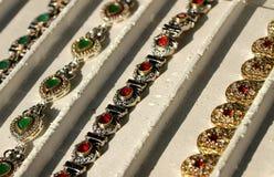 Handmade bracelets with sparkling gemstones for sale by jeweler Stock Photos
