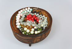 Handmade bracelets in a wooden bowl on an isolated white Royalty Free Stock Image