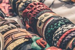 Handmade braided leather bracelets. Selective focus royalty free stock photos