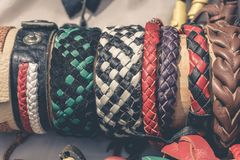 Handmade braided leather bracelets. Toned royalty free stock photos