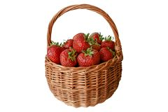 Handmade braided wicker basket full of ripe juicy and fresh strawberries stock images