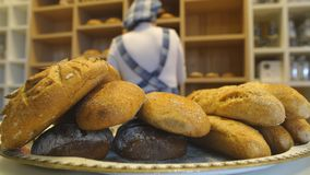 Handmade bread loaves on the counter top of a modern bakery stock video footage