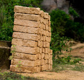 Handmade brick at bukit kapur. indonesia. Nature outdoor park with pond water in limestone mining hill ancient work place at bukit kapur arosbaya east java Royalty Free Stock Photo