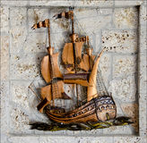Handmade bronze ship and stones Stock Image