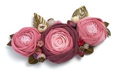 Handmade brooch in the form of three pink fabric flowers on a white background.  Stock Photography
