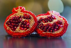 Handmade brooch in shape of pomegranate with red or crimson glass beads and felt Stock Photo