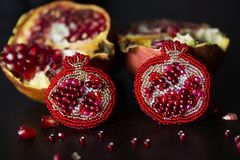 Handmade brooch in shape of pomegranate with red or crimson glass beads and felt Stock Images