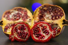 Handmade brooch in shape of pomegranate with red or crimson glass beads and felt Stock Image