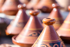 Handmade brown clay tajins for food steaming arranged in rows re Royalty Free Stock Photo