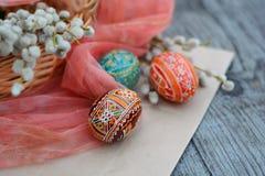 Handmade, brown, Easter egg close up. Handmade, brown, Easter egg on pink cloth close up Stock Photo