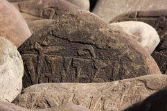 Handmade buddhist mantra on stones Stock Image