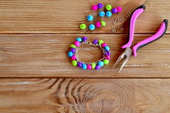 Handmade button bracelet. Set of bright colored buttons, pliers. DIY bangle jewelry idea. Easy make creative crafts Stock Photography