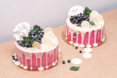 Handmade cake drizzled with white chocolate. And decorated with grapes Stock Photo