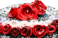 Handmade cake with red and white roses Royalty Free Stock Photography