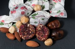 Handmade candies in ciolored paper royalty free stock images
