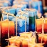 Handmade candles on the market, handicraft for sale, decoration Stock Photography